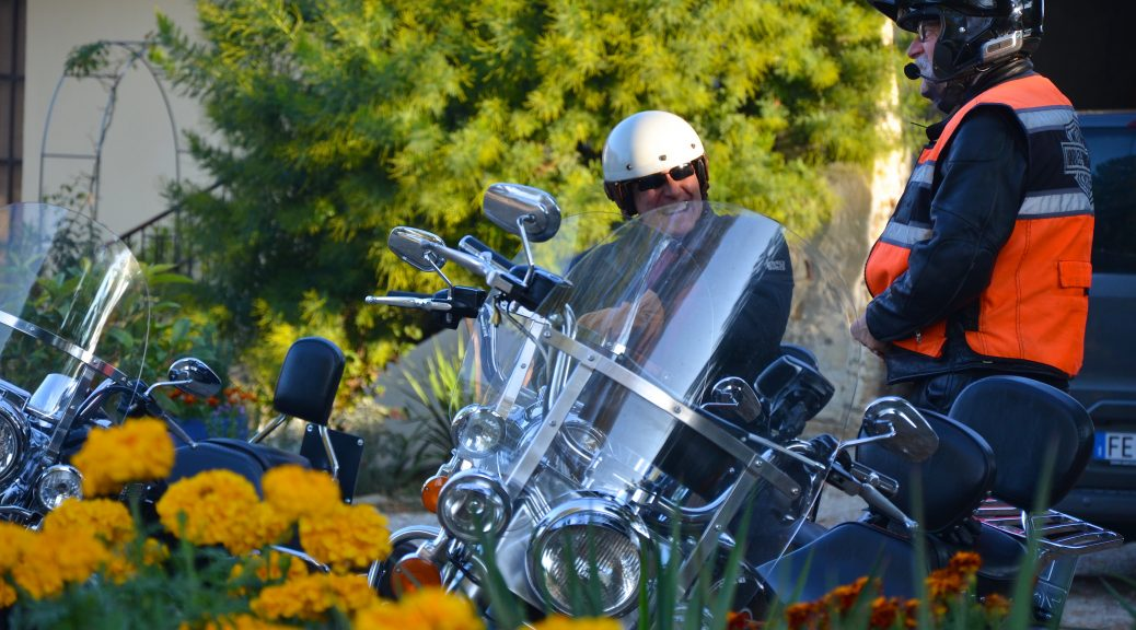 Happy guest on Harley motorcycle